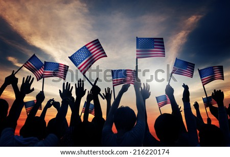 Group of People Waving Armenian Flags in Back Lit - stock photo