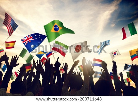 Group of People Waving Flags in World Cup Theme - stock photo