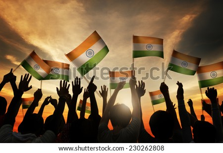 Group of People Waving Indian Flags in Back Lit - stock photo