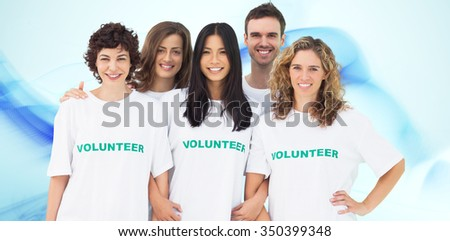 Group of people wearing volunteer tshirt against blue abstract design