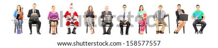 Group of people with different profession sitting on wooden chairs and looking at camera isolated on white background