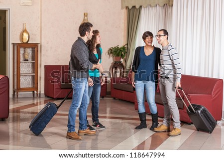 Group of People with Trolley in the Hall - stock photo