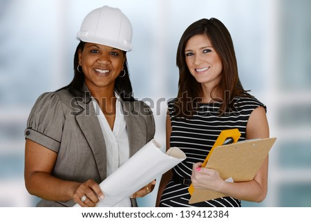 Group of people working at a construction site - stock photo