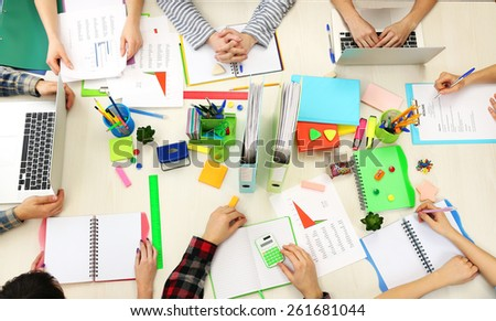 Group of people working at desk top view - stock photo