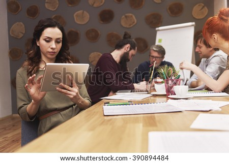 Group of people working at the fashion office  - stock photo