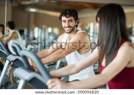 Group of people working out on a stationary bike - stock photo