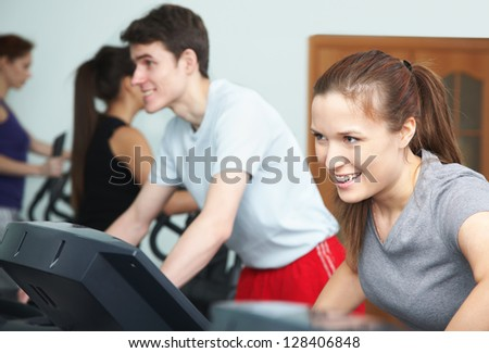 Group of people working out on treadmill in gym - stock photo