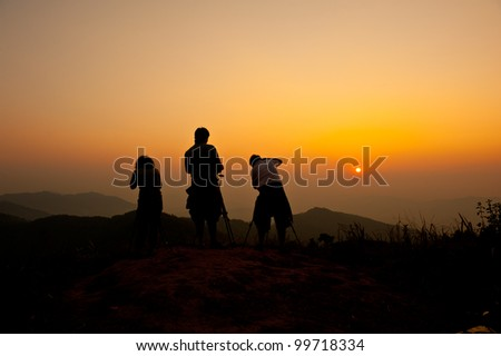 group of photographer in the sunset