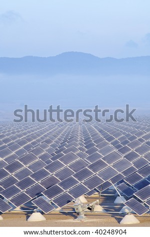group of photovoltaic panels at sunrise