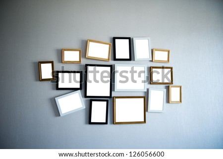 Group of picture frames on the wall. - stock photo