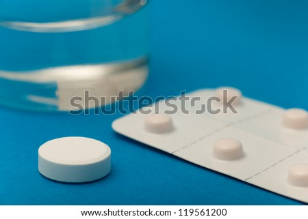 Group of pills in blue background