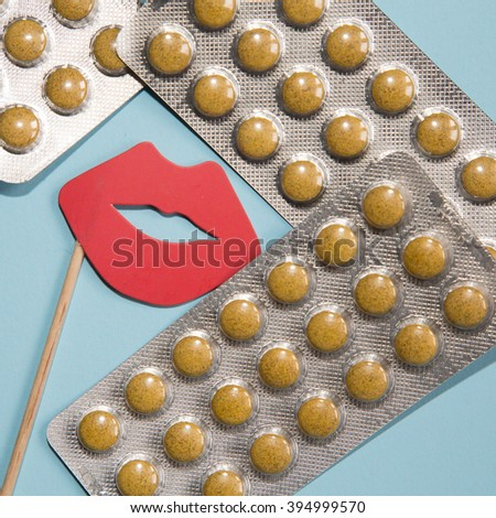 group of pills on blue background - stock photo
