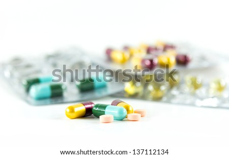 Group of pills on white background