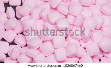 Group of pink medicine on black background, medicines for treatment disease in my clinic , Pink rectangular shape medicines.