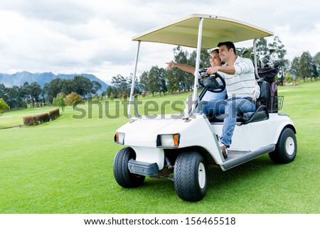 Group of players in a golf cart at the course  - stock photo