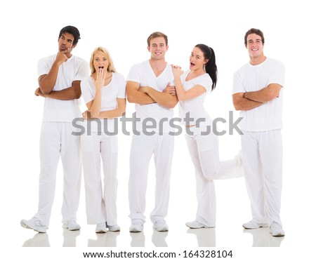 group of playful friends posing on white background