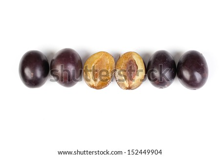 Group of plums line isolated on a white background.