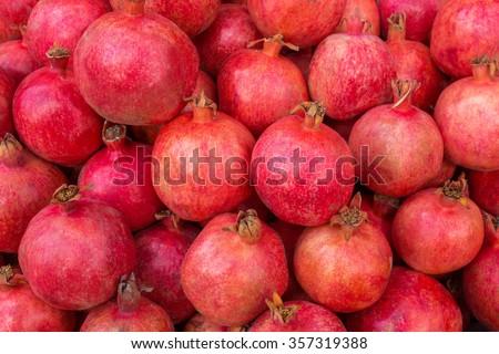 Group of pomegranates. Pomegranate closeup, background - stock photo