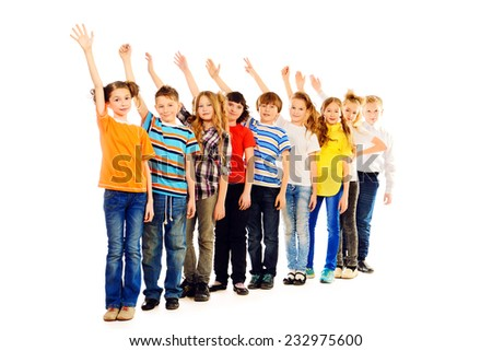 Group of positive children standing together and raise their hands up as a lesson at school. Isolated over white. Full length portrait.