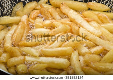 Group of potato chips fried in the fryer  - stock photo