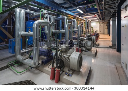 Group of powerful pumps in modern boiler-house