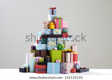 Group of presents. Gift boxes with origami bows. grey background.   - stock photo