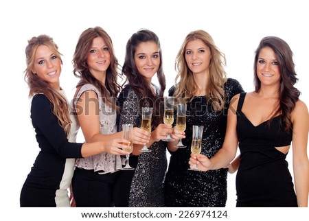 Group of pretty friends toasting with champagne in a celebration during christmas - stock photo