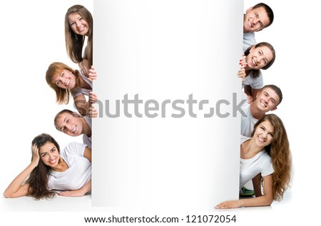 Group of pretty young people looking out white board. - stock photo