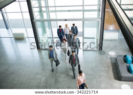 Group of professional business people walking on the way in building  - stock photo