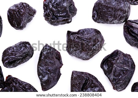 Group of prunes isolated on white, macro - stock photo