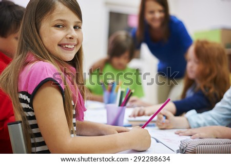Group of pupils during the lesson - stock photo