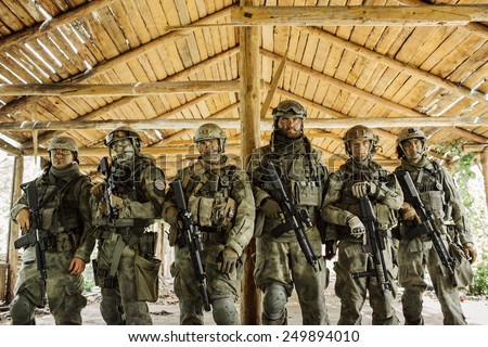 group of rangers standing and looking at the camera - stock photo