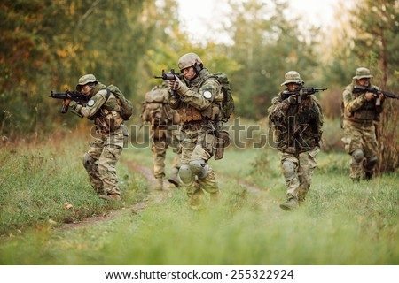 group of rangers was ambushed and returned fire leads - stock photo
