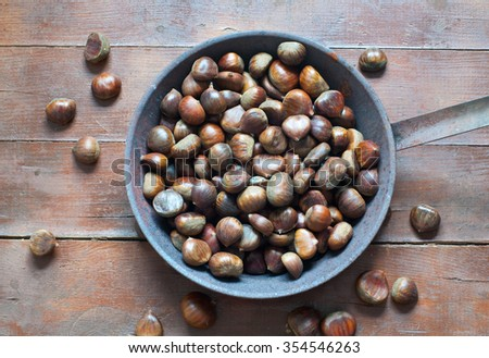 Group of raw chestnuts ready to be cooked,italy