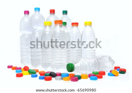 Group of recycling bottles and caps over white background