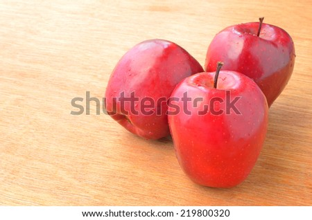 group of red apple on wood background