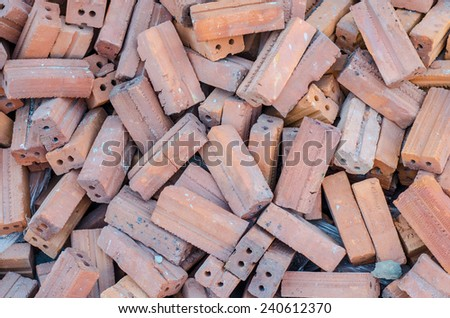 group of red bricks old square construction materials as background - stock photo