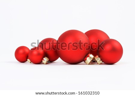Group of red christmas balls on white background  - stock photo