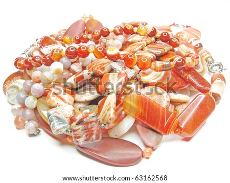 group of red colored beads isolated on white background - stock photo