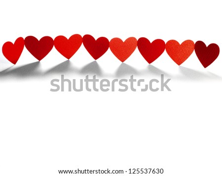 Group of red hearts connected in chain, paper craft - stock photo