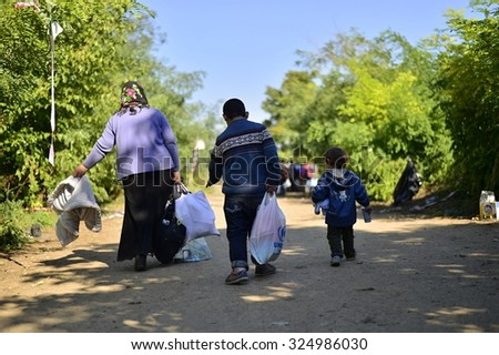 Group of refugees leaving Serbia. They came to Bapska by buses and then they leaving Serbia and go to Croatia and then to Germany. October 4, 2015; Bapska in Serbia.