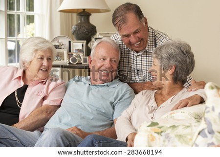 Group Of Retired Friends Sitting On Sofa At Home Together - stock photo