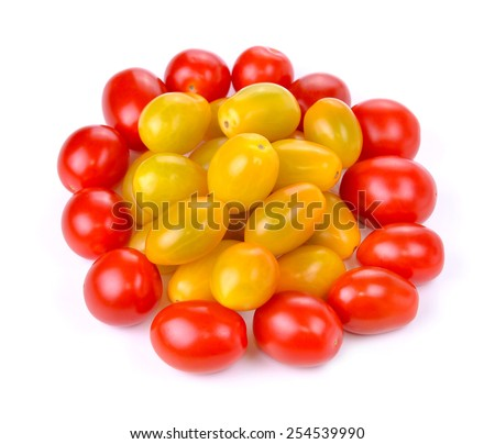 Group of ripe red and gold grape tomatoes isolated against white background - stock photo