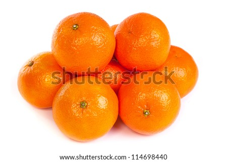 Group of ripe tangerines or mandarin with slice isolated on white background - stock photo