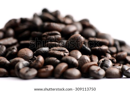 Group of roasted coffee beans on white background - stock photo