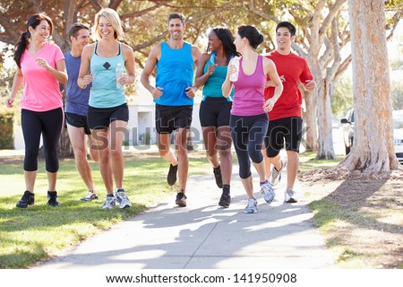 Group Of Runners On Suburban Street - stock photo