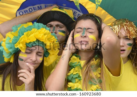 Group of sad crying brazilian soccer fans disappointed with team defeat. - stock photo