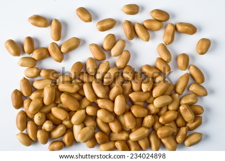 Group of scattered peanuts on white background - top view - stock photo