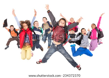Group of school children jumping isolated in white - stock photo