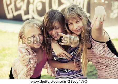 Group of school girls having a fun in campus  - stock photo